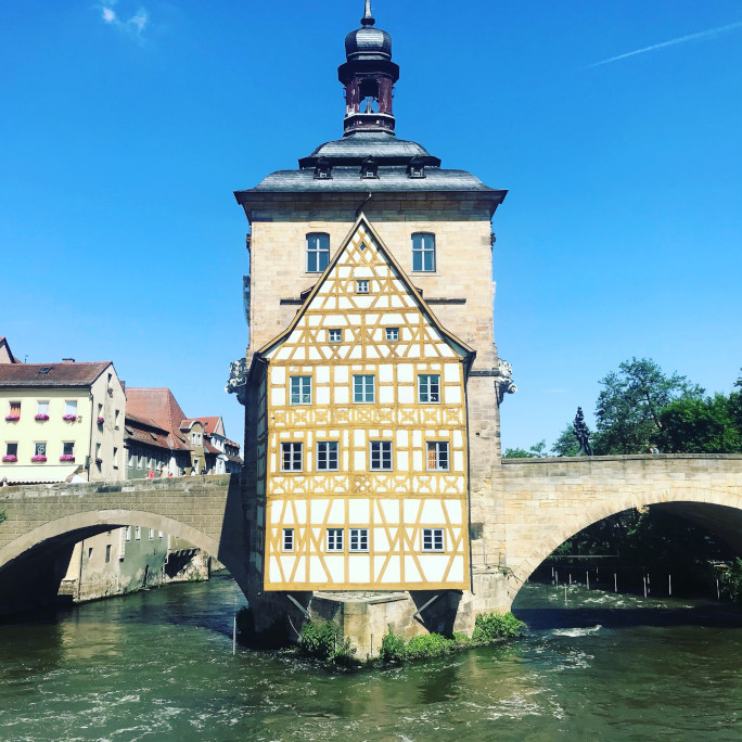 the old town hall in Bamberg, a half-timbered house standing on a bridge in a river