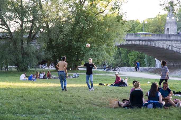 people having a picnic and others playing volleyball
